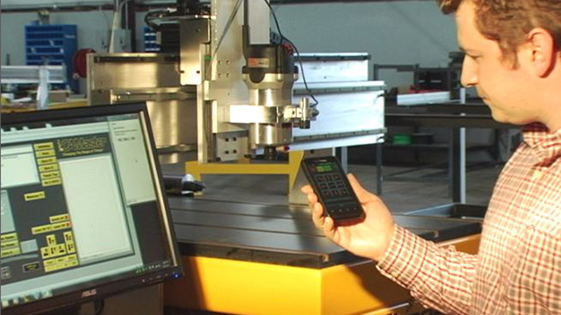 Machine operator using WincncTouch to control a cnc router from his iOS or Android mobile device.